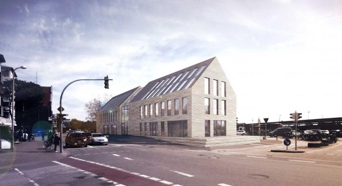 Das Wohn- und Geschäftshaus im Kirchenweg 6 setzt sich aus zwei verklinkerten  Satteldachhäusern zusammen; die Erschließung der oberen Geschosse befindet  sich im verbindenden Glasstück in der Mitte des Bauwerks. Abbildung © Andreas  Heller Architects & Designers